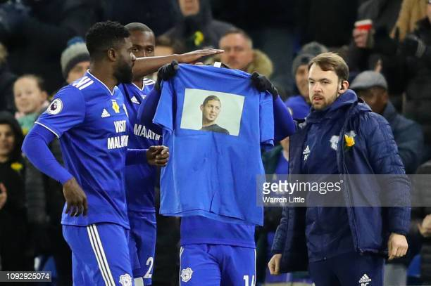 Bobby Reid of Cardiff City celebrates after scoring his team's first goal from the penalty spot by raising a shirt showing their respects for...
