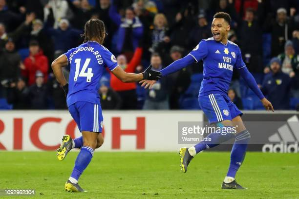 Bobby Reid of Cardiff City celebrates after scoring his team's second goal with Josh Murphy of Cardiff City during the Premier League match between...