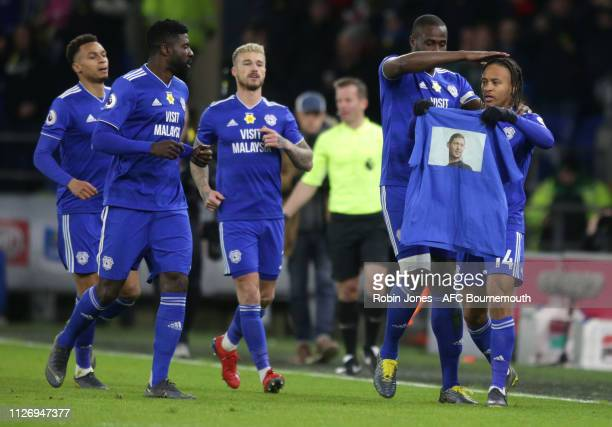 Bobby Reid of Cardiff City scores a goal to make it 1-0 from the spot and holds aloft an image of the missing Cardiff City player Emiliano Sala...