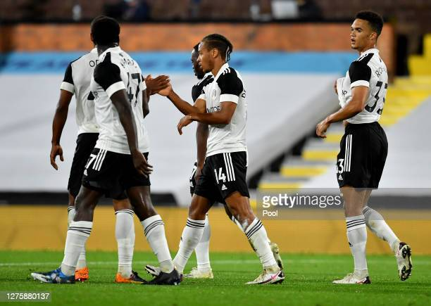 Bobby Reid of Fulham celebrates with teammates after scoring his sides second goal during the Carabao Cup third round match between Fulham and...