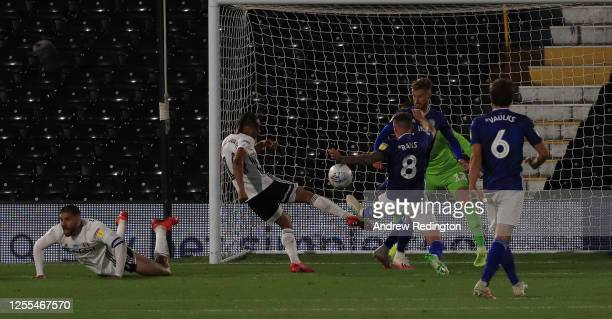 Bobby Reid of Fulham has his shot blocked by Joe Ralls of Cardiff City during the Sky Bet Championship match between Fulham and Cardiff City at...