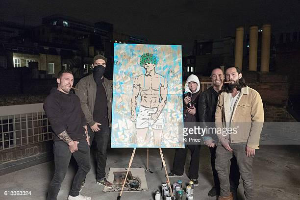 Bobby Rich Endless Rocco Ritchie Simon Salter Andrew Salter after Artist Endless finish artwork of Mark Wahlberg on a rooftop in Mayfair on October 8...