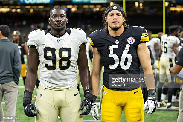 Bobby Richardson of the New Orleans Saints poses after a preseason game with Anthony Chickillo of the Pittsburgh Steelers at MercedesBenz Superdome...