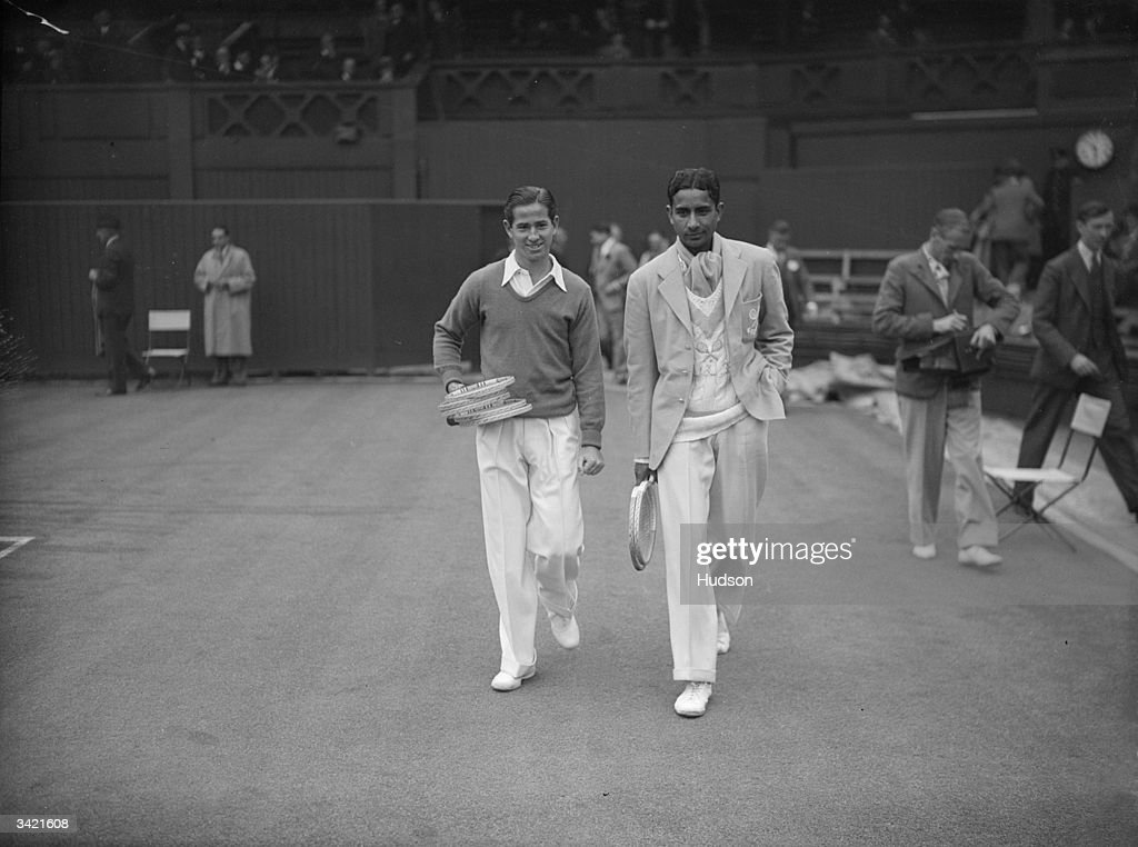 Bobby Riggs (1918 - 1995, left) of the USA, and J N Dhamija of India, before their first round singles match at Wimbledon, 26th June 1939. Riggs won the match 6-3, 6-0, 6-4.