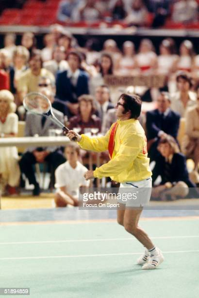 Bobby Riggs watches the play after swinging against Billy Jean King in the 'Battle of the Sexes' Challenge Match at the Astrodome on September 20...
