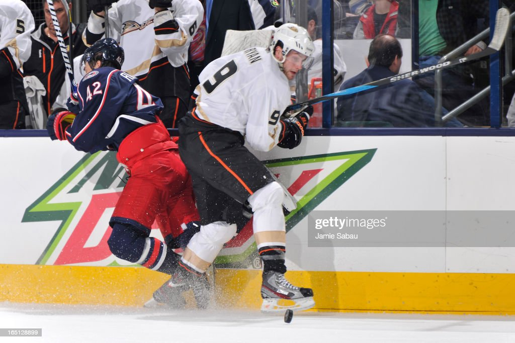 Bobby Ryan #9 of the Anaheim Ducks checks Artem Anisimov #42 of the Columbus Blue Jackets off the puck during the third period on March 31, 2013 at Nationwide Arena in Columbus, Ohio. Columbus defeated Anaheim 2-1 in overtime.