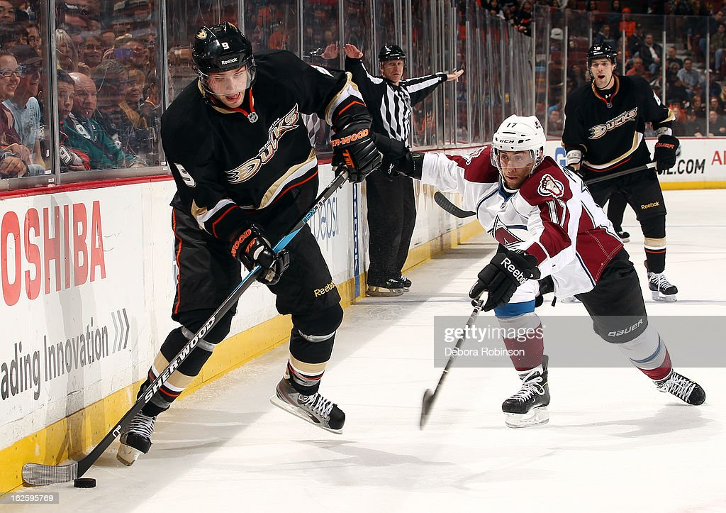 Bobby Ryan #9 of the Anaheim Ducks handles the puck against Aaron Palushaj #17 of the Colorado Avalanche on February 24, 2013 at Honda Center in Anaheim, California.