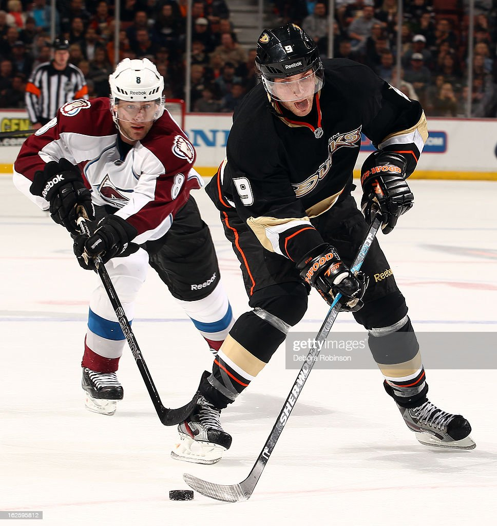 Bobby Ryan #9 of the Anaheim Ducks handles the puck against Jan Hejda #8 of the Colorado Avalanche on February 24, 2013 at Honda Center in Anaheim, California.