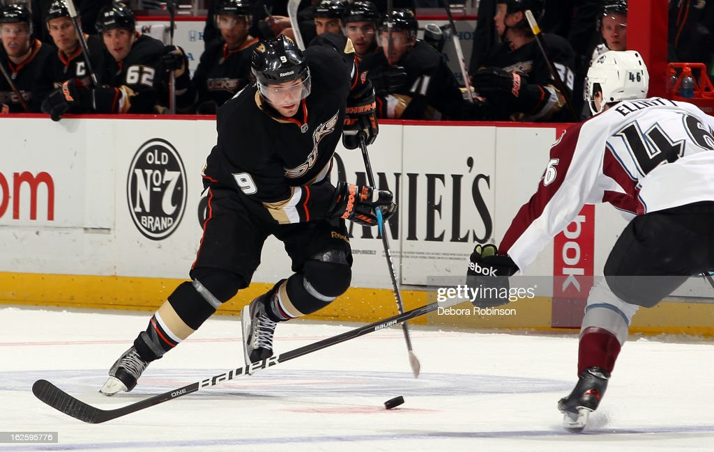 Bobby Ryan #9 of the Anaheim Ducks handles the puck against Stefan Elliott #46 of the Colorado Avalanche on February 24, 2013 at Honda Center in Anaheim, California.