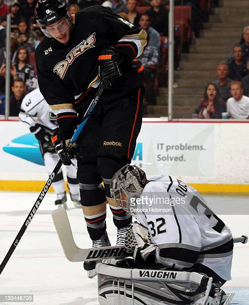 Bobby Ryan of the Anaheim Ducks jumps in the air as he defends against Jonathan Quick of the Los Angeles Kings during the game on November 17 2011 at...