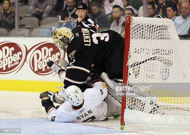 Bobby Ryan of the Anaheim Ducks slides into Kari Lehtonen of the Dallas Stars at the American Airlines Center on October 26 2010 in Dallas Texas