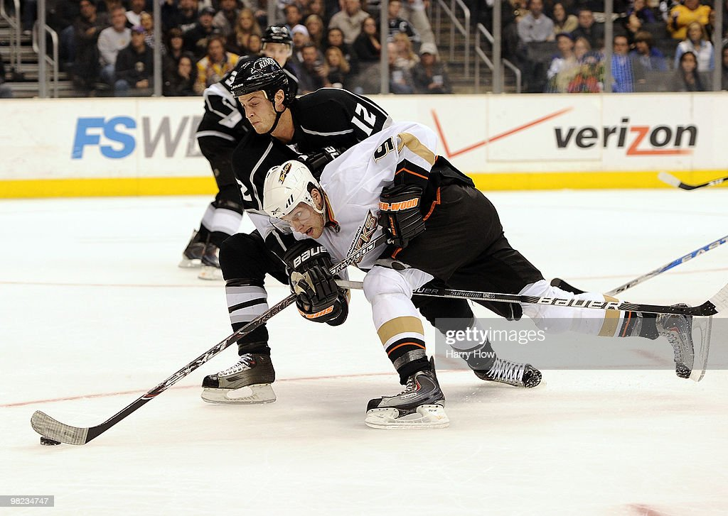 Bobby Ryan #9 of the Anaheim Ducks stretches to get a shot past Randy Jones #12 of the Los Angeles Kings during the third period at the Staples Center on April 3, 2010 in Los Angeles, California.