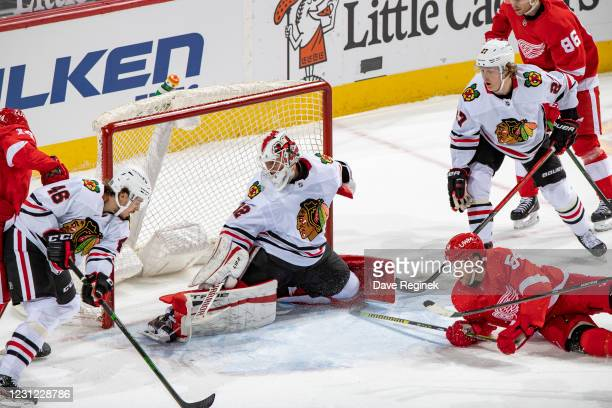 Bobby Ryan of the Detroit Red Wings goes to the net as goalie Kevin Lankinen of the Chicago Blackhawks and teammates Lucas Carlsson and Adam Boqvist...