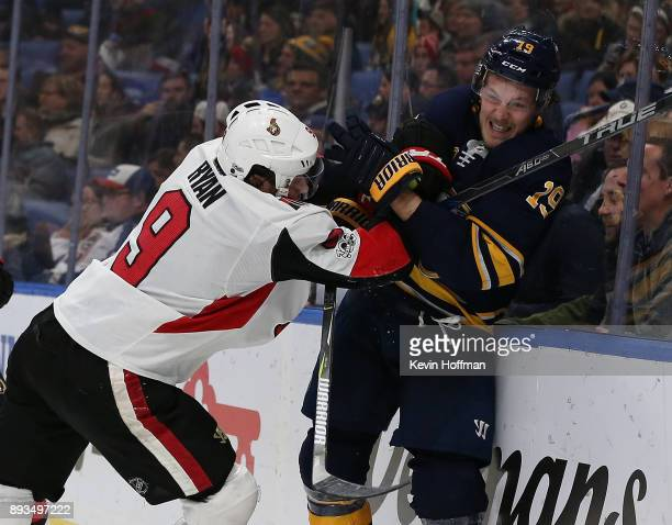 Bobby Ryan of the Ottawa Senators and Zemgus Girgensons of the Buffalo Sabres at the KeyBank Center on December 12 2017 in Buffalo New York
