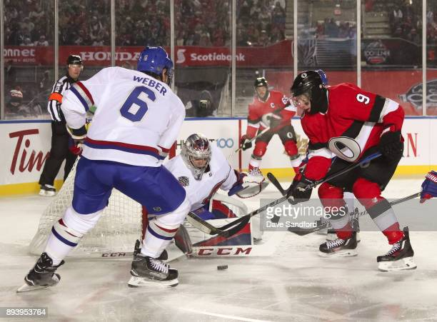 Bobby Ryan of the Ottawa Senators battles for a loose puck with Shea Weber and Carey Price of the Montreal Canadiens during the 2017 Scotiabank...
