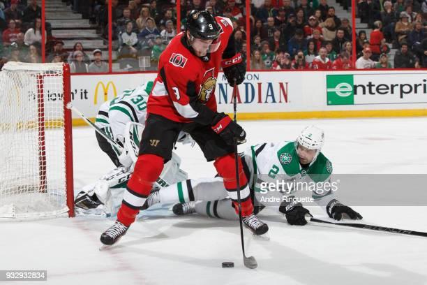 Bobby Ryan of the Ottawa Senators controls the puck outside the crease as Dan Hamhuis of the Dallas Stars drops to block the puck at Canadian Tire...
