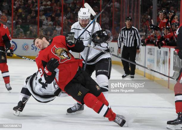 Bobby Ryan of the Ottawa Senators loses his helmet as he collides with Nate Thompson and Kyle Clifford of the Los Angeles King at Canadian Tire...
