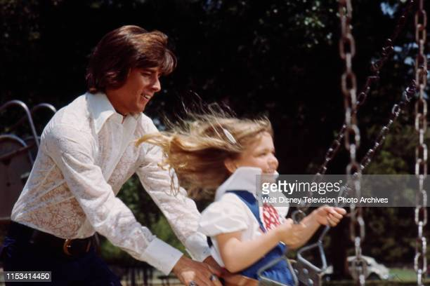 Bobby Sherman pushing young girl on swing on the ABC tv special 'The Bobby Sherman Special'