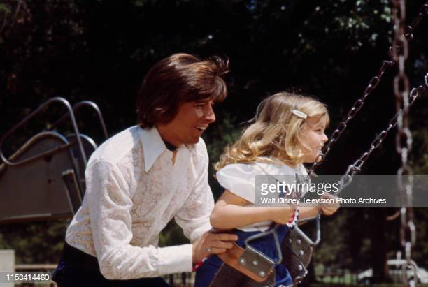 Bobby Sherman pushing young girl on swing on the ABC tv special 'The Bobby Sherman Special'