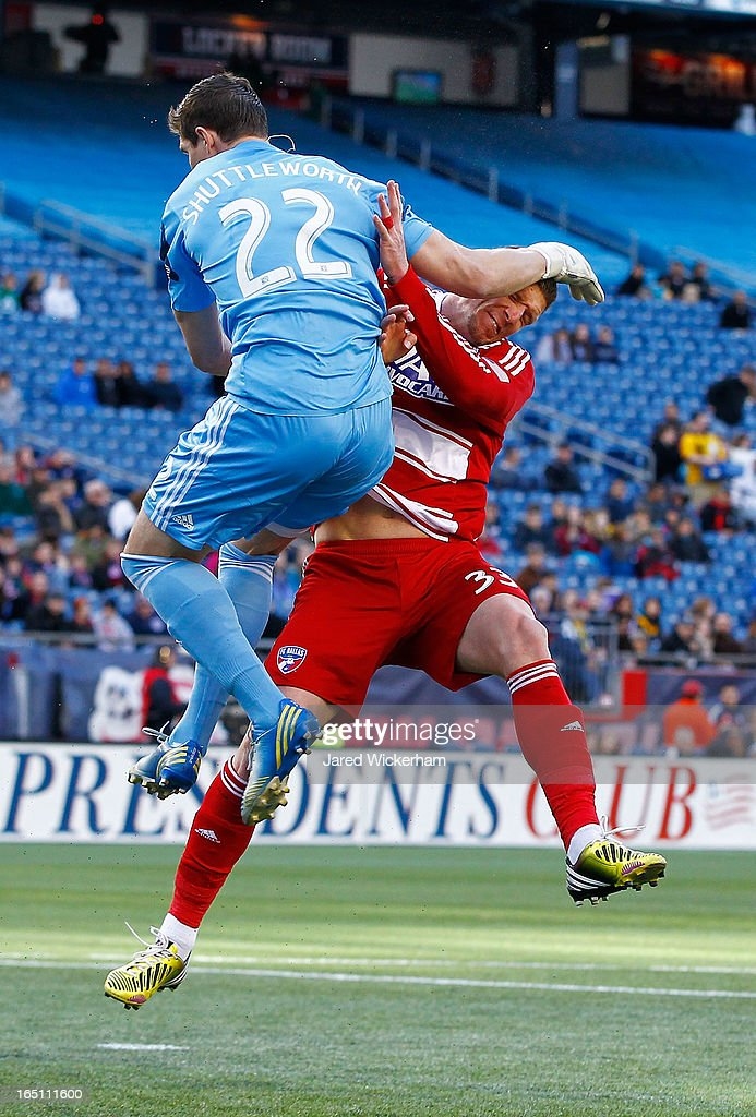 Bobby Shuttleworth #34 of New England Revolution collides with Kenny Cooper #33 of FC Dallas while making a save on the ball during the game at Gillette Stadium on March 30, 2013 in Foxboro, Massachusetts.