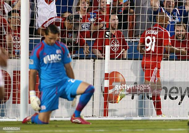 Bobby Shuttleworth of New England Revolution looks down after letting Andres Escobar of FC Dallas into the goal at Toyota Stadium on July 19 2014 in...