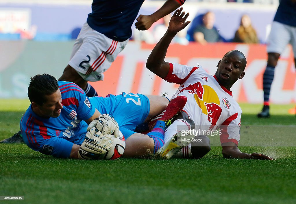 Bobby Shuttleworth #22 of New England Revolution makes a save against Lloyd Sam #10 of New York Red Bulls during the Eastern Conference Final - Leg 1 at Red Bull Arena on November 23, 2014 in Harrison, New Jersey. Revolution defeated the Red Bulls 2-1.
