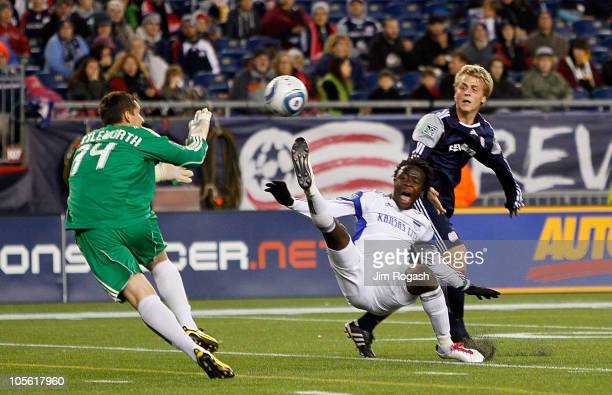 Bobby Shuttleworth of the New England Revolution prepares to make a save against Kei Kamara of the Kansas City Wizards as Seth Sinovic of the New...