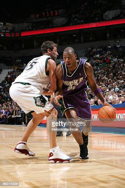 Bobby Simmons of the Milwaukee Bucks drives to the basket around Marko Jaric of the Minnesota Timberwolves on November 25 2005 at the Target Center...