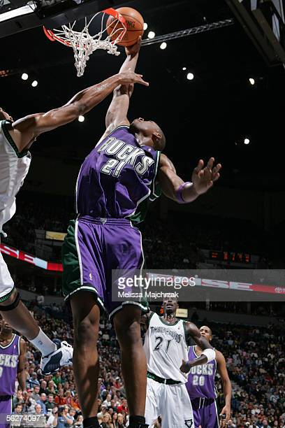 Bobby Simmons of the Milwaukee Bucks puts the ball in the basket against the Minnesota Timberwolves on November 25 2005 at the Target Center in...