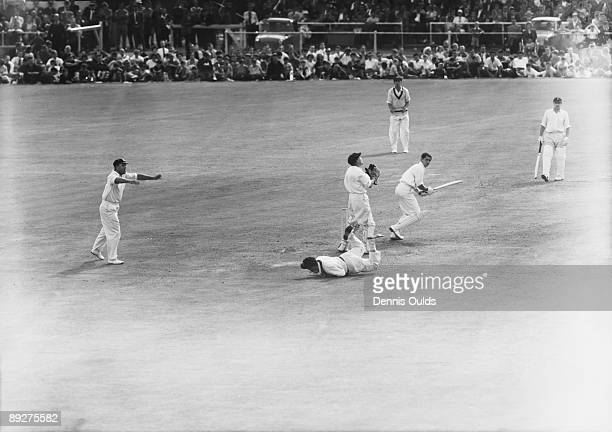 Bobby Simpson dives to dismiss David Allen off Richie Benaud for 10 during England's disastrous second innings at Old Trafford, on the last day of...