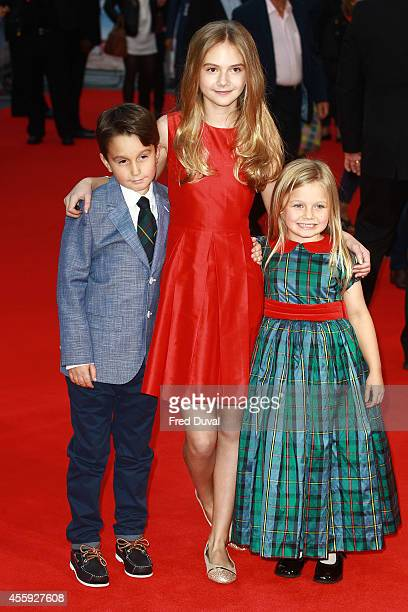 Bobby Smalldridge Emilia Jones and Harriet Turnbull attend the What We Did On Holiday premiere at Odeon West End on September 22 2014 in London...
