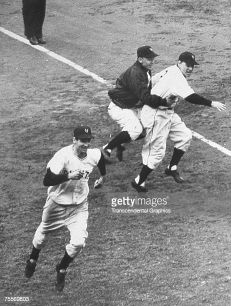 Bobby Thomson has just rounded third base, on his way to scoring the winning run after hitting a home run in a playoff game for the National League...