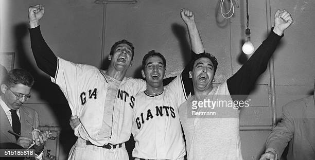 Bobby Thomson Larry Jansen and Sal Maglie celebrate in their locker room following the Giants' Game 3 playoff victory over the Brooklyn Dodgers...