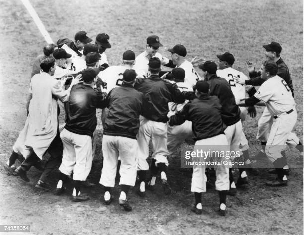 Bobby Thomson, surrounded by New York Giant teammates, touches home plate after his walk off home run defeated the Brooklyn Dodgers for the National...
