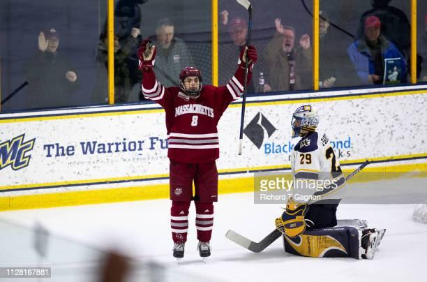 Bobby Trivigno of the Massachusetts Minutemen celebrates his goal against the Merrimack College Warriors during NCAA men's hockey at Lawler Rink on...