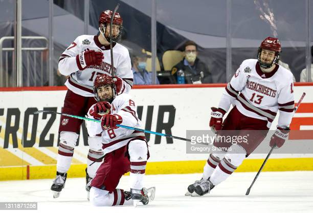 Bobby Trivigno of the Massachusetts Minutemen celebrates with Philip Lagunov and Reed Lebster after scoring a goal against the St. Cloud St. Huskies...