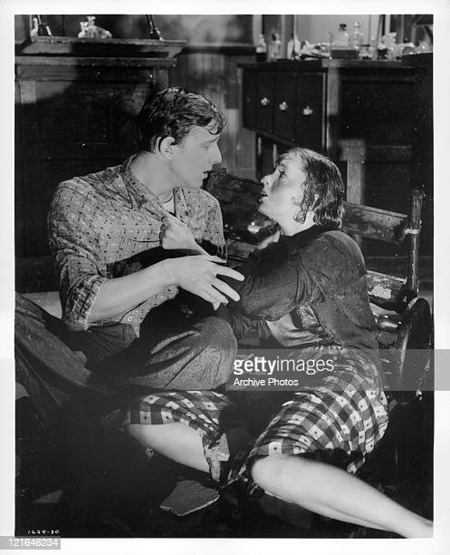Bobby Van And Debbie Reynolds hold one another in chemistry lab after explosion in a scene from the film 'Affairs Of Dobie Gillis' 1953