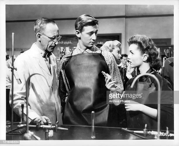 Bobby Van And Debbie Reynolds in chemistry lab in a scene from the film 'Affairs Of Dobie Gillis' 1953