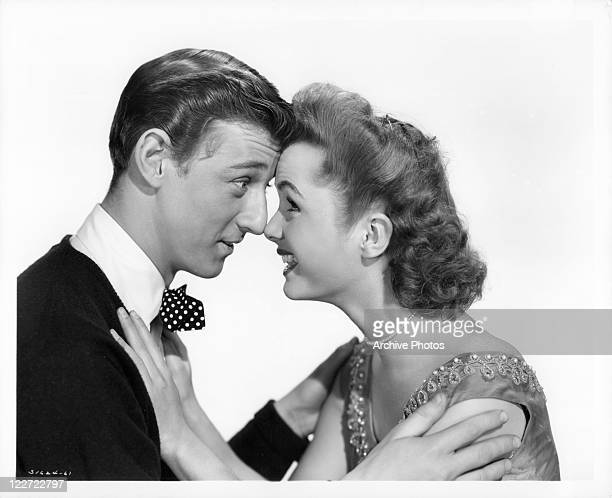 Bobby Van and Debbie Reynolds nose to nose in a scene from the film 'The Affairs Of Dobie Gillis' 1953