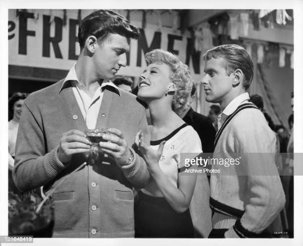 Bobby Van looks back at Barbara Ruick who flirts with him in a scene from the film 'Affairs Of Dobie Gillis' 1953