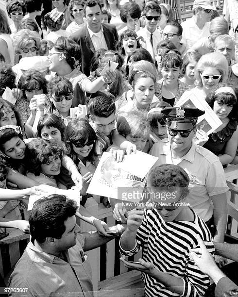 Bobby Vinton recording star is mobbed by autograph seekers after one of free shows which helped to draw millions to Palisades Amusement Park