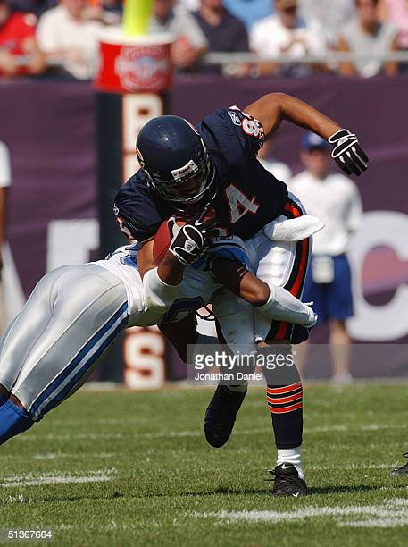 Bobby Wade of the Chicago Bears is tackled by Fernando Bryant of the Detroit Lions on September 12 2004 at Soldier Field in Chicago Illinois The...