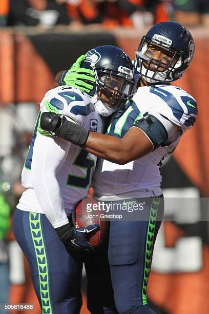 Bobby Wagner and KJ Wright of the Seattle Seahawks celebrate a touchdown during their game against the Cincinnati Bengals at Paul Brown Stadium on...