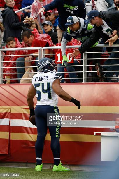 Bobby Wagner of the Seattle Seahawks celebrates with fans after recovering a turnover against the San Francisco 49ers at Levi's Stadium on November...