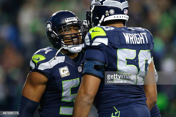 Bobby Wagner of the Seattle Seahawks celebrates with KJ Wright of the Seattle Seahawks in the end zone after recovering a fumble by Carson Palmer of...