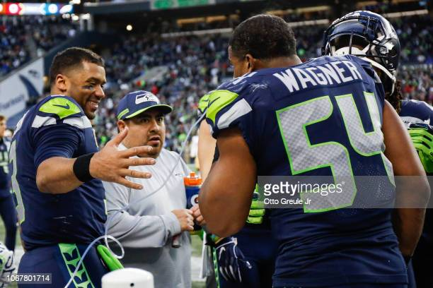 Bobby Wagner of the Seattle Seahawks celebrates with Russell Wilson after an interception return for a touchdown in the fourth quarter against the...