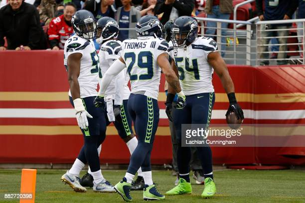 Bobby Wagner of the Seattle Seahawks celebrates with teammates after recovering a turnover against the San Francisco 49ers at Levi's Stadium on...