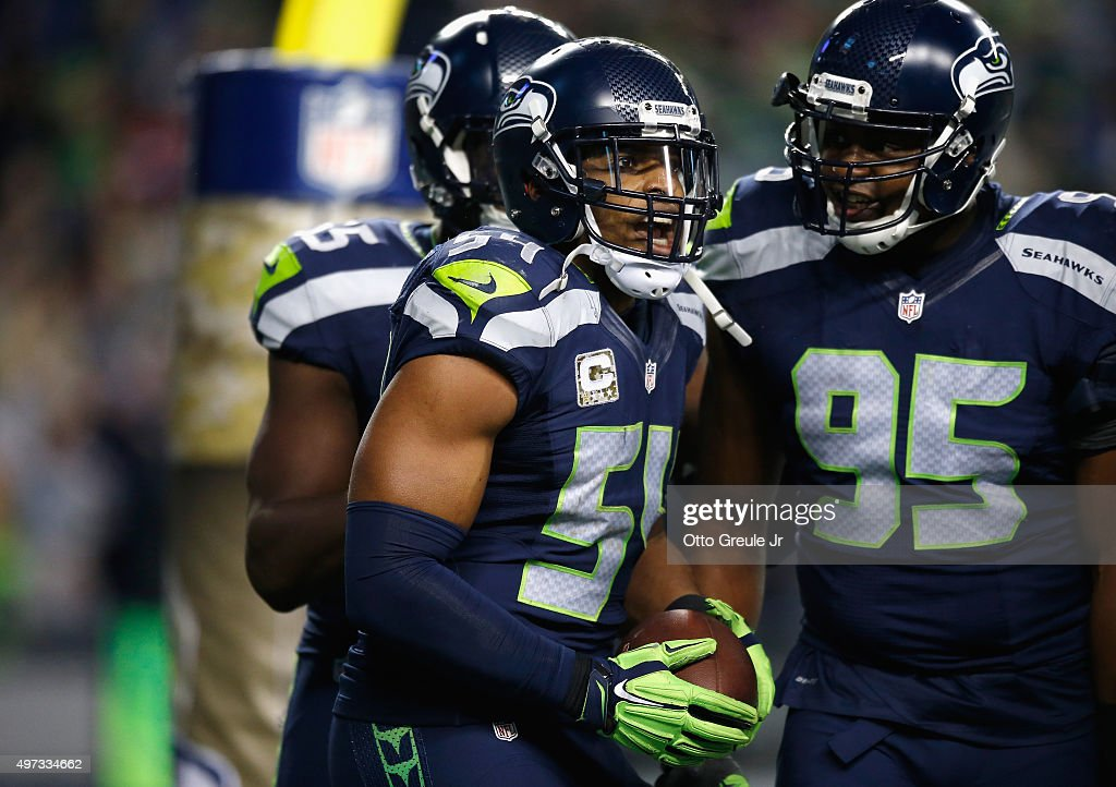 Bobby Wagner #54 of the Seattle Seahawks celebrates with teammates in the end zone after recovering a fumble by Carson Palmer #3 of the Arizona Cardinals (not pictured) and returning it for a touchdown during the fourth quarter at CenturyLink Field on November 15, 2015 in Seattle, Washington.