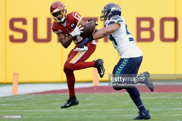 Bobby Wagner of the Seattle Seahawks deflects a pass intended for Terry McLaurin of the Washington Football Team at FedExField on December 20, 2020...