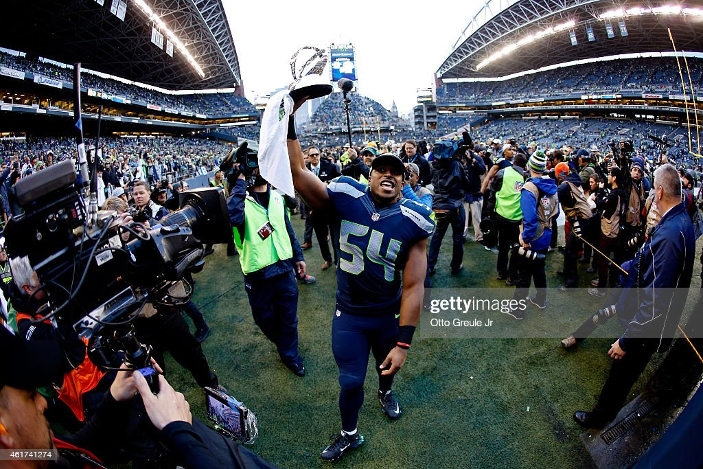 Bobby Wagner #54 of the Seattle Seahawks holds up the George S. Halas trophy as he walks off the field after the Seahawks defeated the Green Bay Packers in the 2015 NFC Championship game at CenturyLink Field on January 18, 2015 in Seattle, Washington.